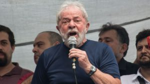 """Brazilian ex-president (2003-2011) Luiz Inacio Lula da Silva (L) speaks during a Catholic mass in memory of Lula's late wife Marisa Leticia, at the metalworkers' union building in Sao Bernardo do Campo, in metropolitan Sao Paulo, Brazil, on April 7, 2018. Brazil's election frontrunner and controversial leftist icon said Saturday that he will comply with an arrest warrant to start a 12-year sentence for corruption. """"I will comply with their warrant,"""" he told a crowd of supporters. / AFP PHOTO / NELSON ALMEIDA"""