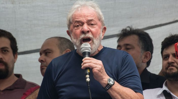"Brazilian ex-president (2003-2011) Luiz Inacio Lula da Silva (L) speaks during a Catholic mass in memory of Lula's late wife Marisa Leticia, at the metalworkers' union building in Sao Bernardo do Campo, in metropolitan Sao Paulo, Brazil, on April 7, 2018. Brazil's election frontrunner and controversial leftist icon said Saturday that he will comply with an arrest warrant to start a 12-year sentence for corruption. ""I will comply with their warrant,"" he told a crowd of supporters. / AFP PHOTO / NELSON ALMEIDA"